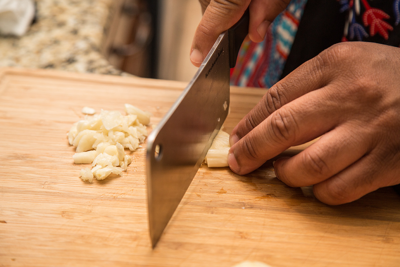 Chopping the garlic.